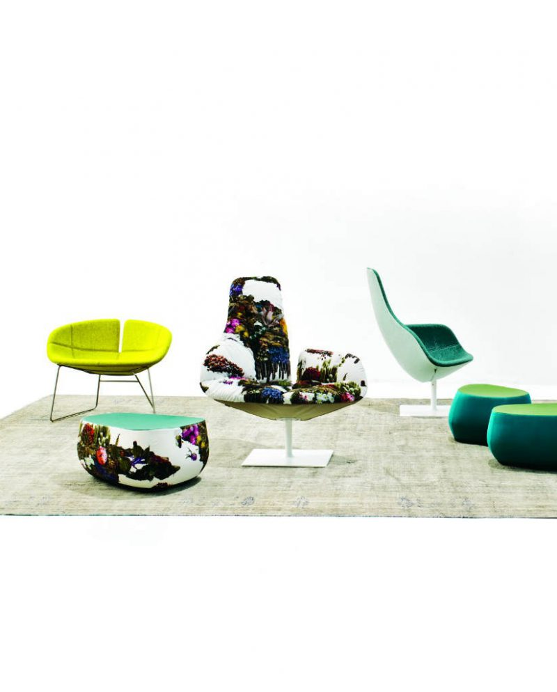 Fjord Seat is injected flame-retardant foam over internal steel frame covered in fabric or leather. Tubular stainless steel sled base with footrest.