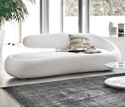 Duny Daybed This sofa will embrace you like a glove; its every finishing - both leather and eco-leather - exholt its peculiar shape and curves.