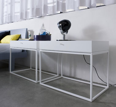 BOX SLIM A slim metal frame supporting simple shelves or a tower of drawers