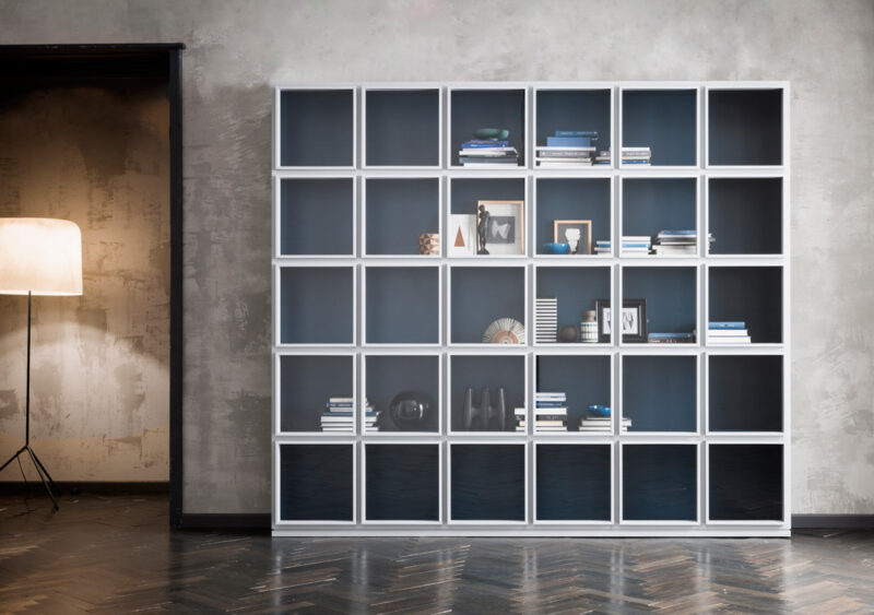 Concept Concept is a bookshelf-display with a solid lacquered wood frame and single, independent glass doors that open; they visually divide the furniture into modules to furnish your walls in a personal manner.