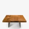 Auckland Block Kauri Coffee table with a top in solid Kauri, consisting of squared blocks with contrasting grain. Natural iron base.