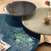 Lakes Coffee table with 10 mm fused, tempered and back-lacquered glass top with metal shades Lava Grey, Copper Brown, Night Blue or Champagne.