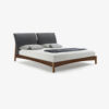 Sleepy Bed with structure made of solid wood and curved padded headboard covered with leather or fabric. Rounded bed sides.