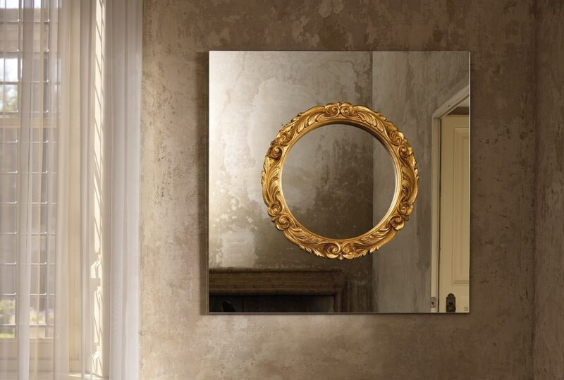Ritratto Wall mirror with wooden frame mounted directly on the mirror surface. The round Baroque style frame is available in gold or silver finishes.