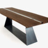 Bedrock Plank C Resin Table with top made of solid wood, consisting of two single planks with natural sides joined through a refined central resin filling. Walnut combined with transparent resin and oak combined with black resin. Base in iron plate characterised by geometric lines.