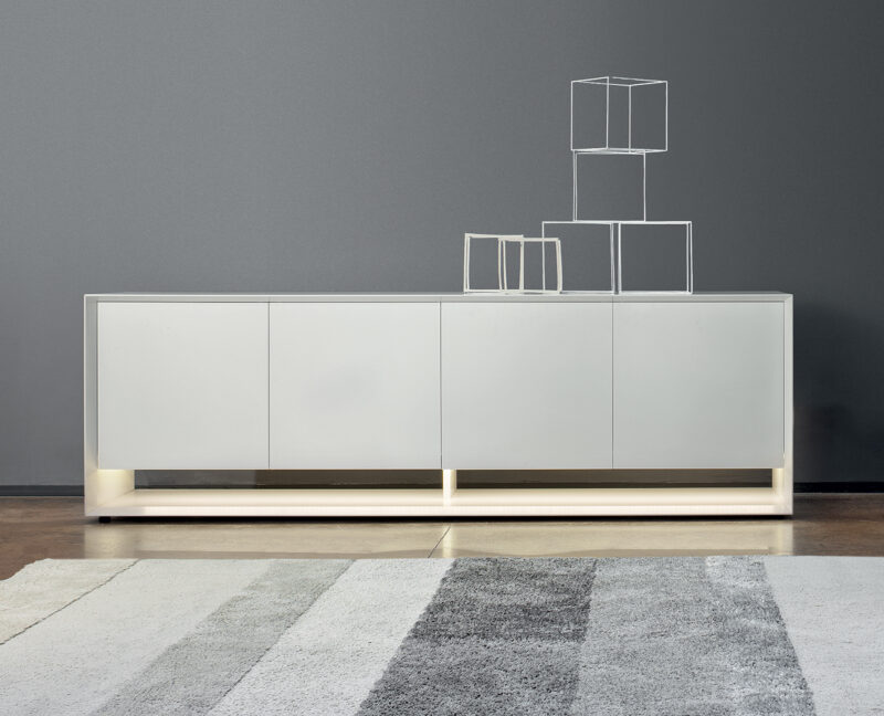 SUNRISE Designed by Gino Carollo, Sunrise is a sideboard with three or four doors fitted side by side