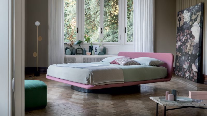 Giotto The lower part of the Giotto bed, made in white or black painted metal, harmoniously supports the sleeping level and can be chosen from two different formal versions: an original cylindrical base (Giotto) or the classic four feet (Giotto Met).