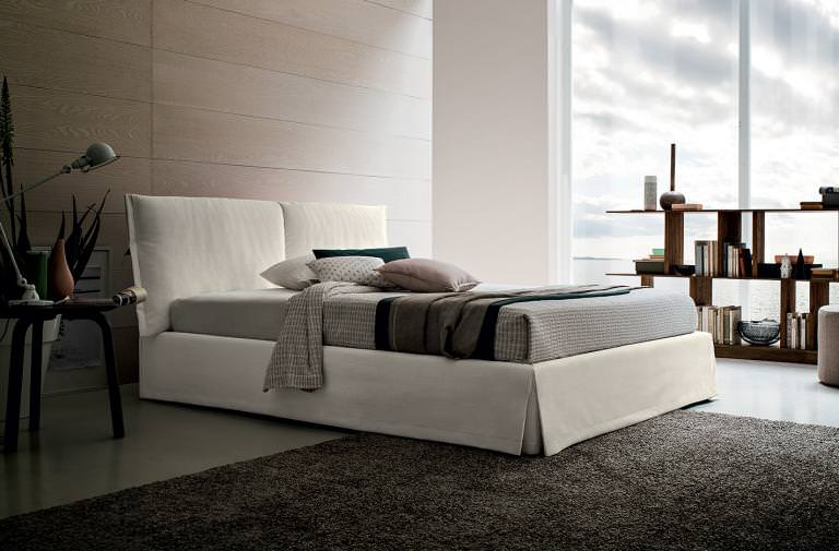 "EMILY Contemporary and minimal headboard, with particular ""pillow case-like"" processing.